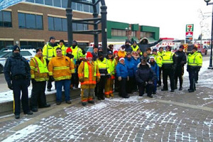 Group of police officers, fire fighters and Bonnyvill Victim Services staff posing for a group photo outside